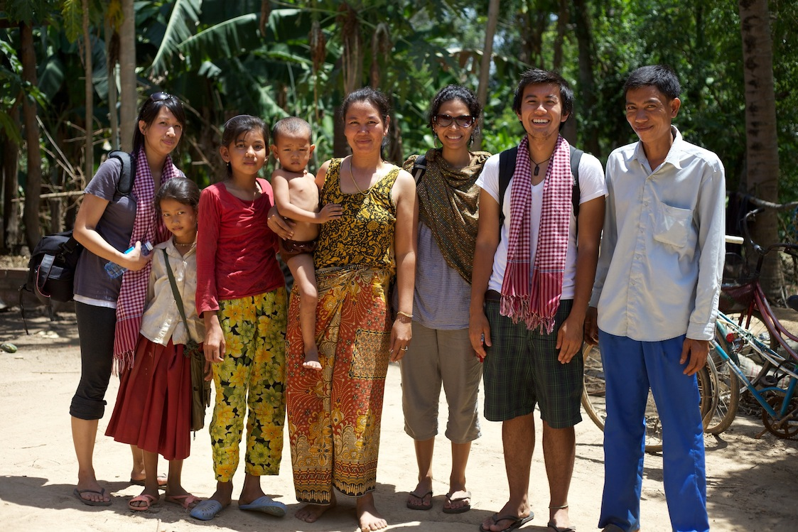 Interns from the AJA J.A.M program and Co-Founder Vinita with villagers in Kampang commune.